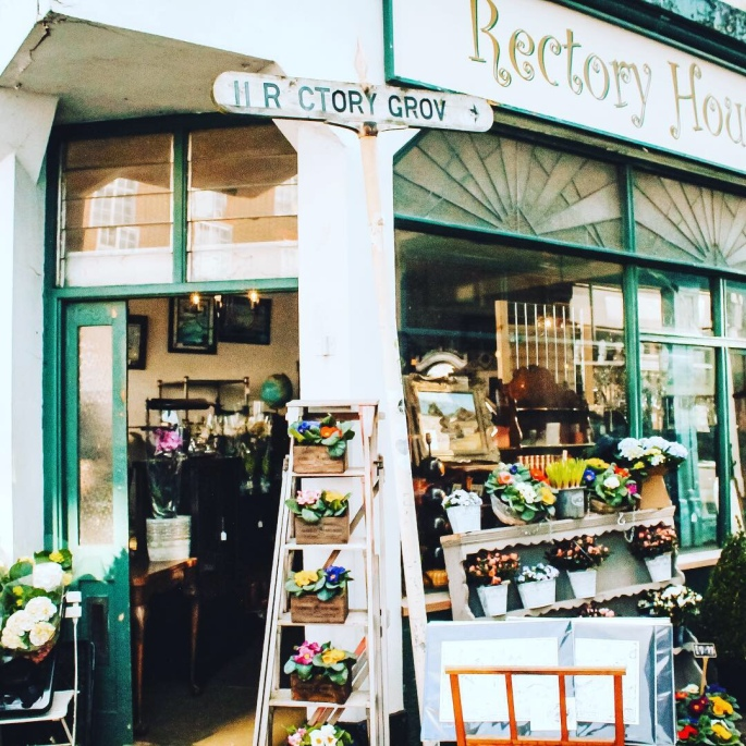 A vintage furniture shop with florist outside