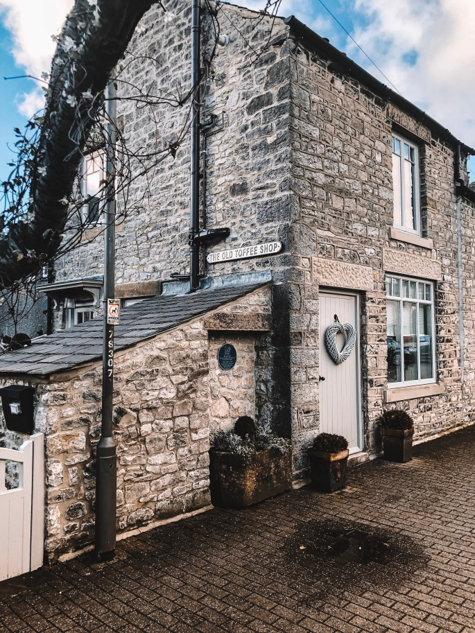 The outside of The Old Toffee Shop - an old and quaint holiday cottage Tideswell