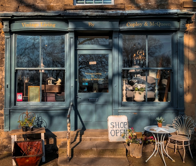 The front of a shop called Vintage Living by Copley & McQueen Baslow