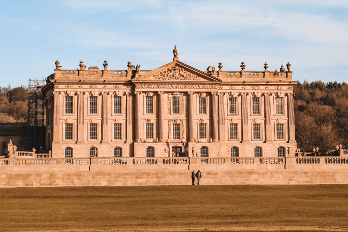 The front of Chatsworth house on a sunny day.