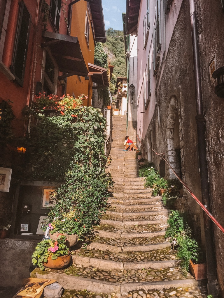 Steep stairs lined with colourful fishing houses in Varenna, Lake Como