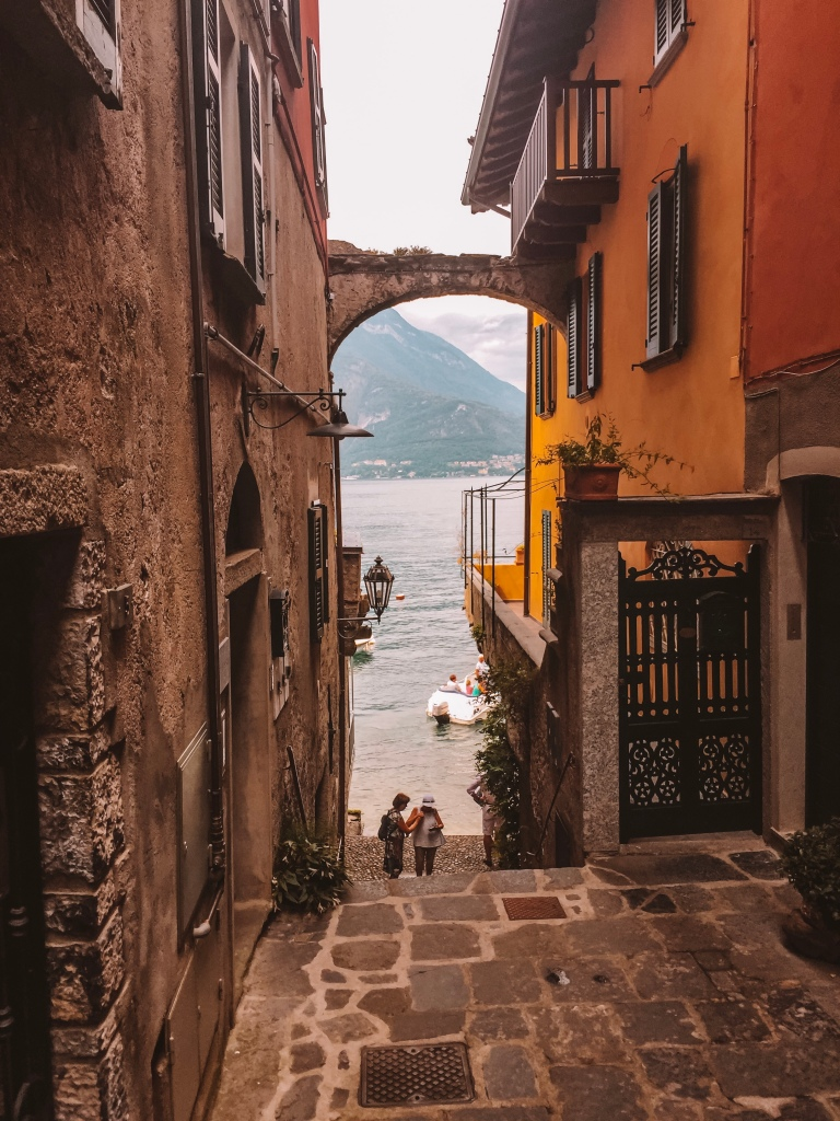 Quaint, narrow street looking down to the lake in Varenna
